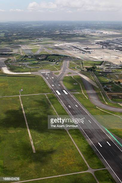 In this aerial image 'B' runway and the bent approach to avoid the land owned by protesters is seen at Narita International Airport on June 10 2010...
