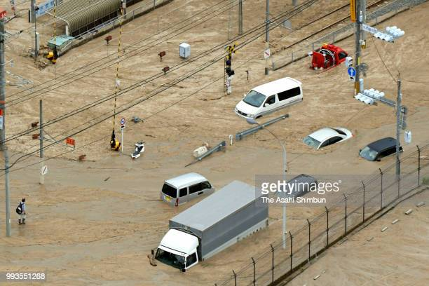 In this aerial image cars are buried by mudslide near JR Mizushiri Station due to heavy rain on July 7 2018 in Saka Hiroshima Japan 51 people were...