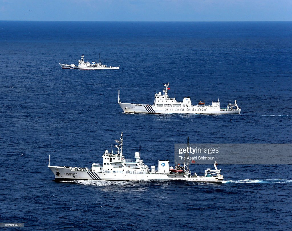 In this aerial image, Chinese marine surveillance ships run along with a Japan Coast Guard patrol ship (top) near Uotsuri island, one of the disputed Senkaku/Daioyu Islands on September 14, 2012 in Ishigaki, Okinawa, Japan. Japanese government purchased the three islets of the Senkaku islands where both Japan and China claim sovereignty.