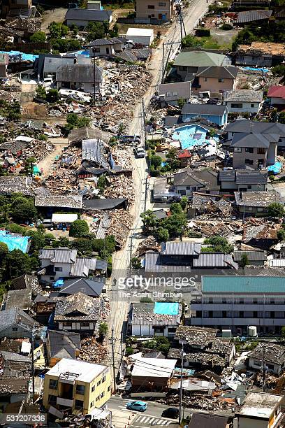 In this aerial image collapsed and damaged house remain on May 13 2016 in Kumamoto Japan It has been one month since the first strong earthquake hit...