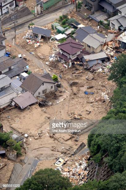 In this aerial image damaged houses are seen after a landslide due to heavy rain on July 7 2018 in Hiroshima Japan 51 people were killed and 58...