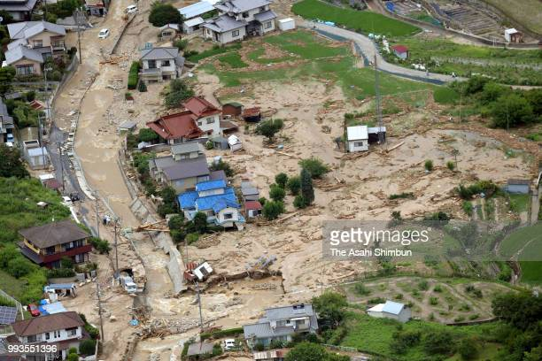 In this aerial image damaged houses are seen after a landslide due to heavy rain on July 7 2018 in Saka Hiroshima Japan 51 people were killed and 58...