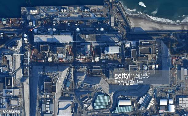 In this aerial image damaged No 1 to No4 reactors are seen at Tokyo Electric Power Co 's Fukushima Daiichi Nuclear Power Plant on December 11 2017 in...