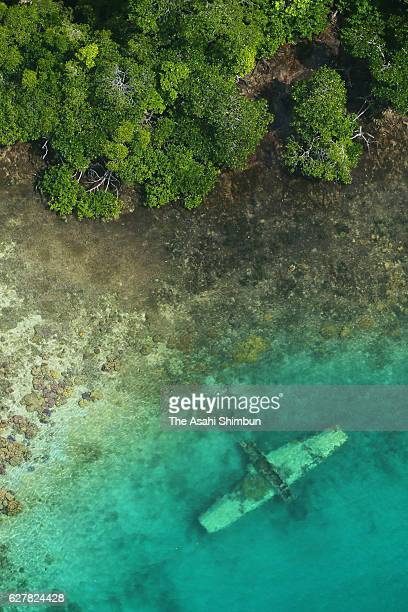 In this aerial image debris of Imperial Japan Navy Type Zero Reconnaissance Seaplane remains at shallow water on September 1 2016 in Solomon Islands...