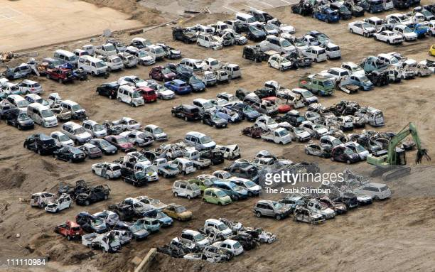 In this aerial image destroyed cars by the earthquake and the tsuanmi are arranged on March 25 2011 in Miyako Iwate Japan More than three weeks after...