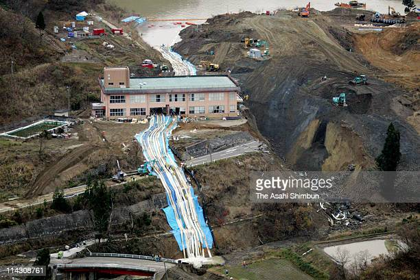 In this aerial image, draining work continue to pull water from flooded Higashi Takezawa area is seen on November 19, 2004 in Yamakoshi, Niigata,...