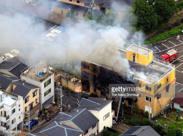 In this aerial image, fire breaks out at a studio of Kyoto Animation Co. On July 18, 2019 in Kyoto, Japan. Police suspect an arsonist set a fire that...