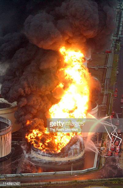 In this aerial image firefighters attempt to extinguish the fire at Idemitsu Kosan Hokkaido Refinary on September 29 2003 in Tomakomai Hokkaido Japan