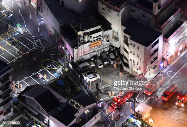 In this aerial image firefighting vehicles surround a building where a sex service parlour is located on December 17 2017 in Saitama Japan 4 Four...