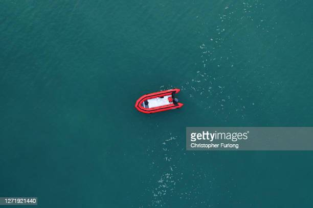 In this aerial image from a drone, an empty migrant dinghy floats off the beach at St Margaret's Bay after the occupants landed from France on...