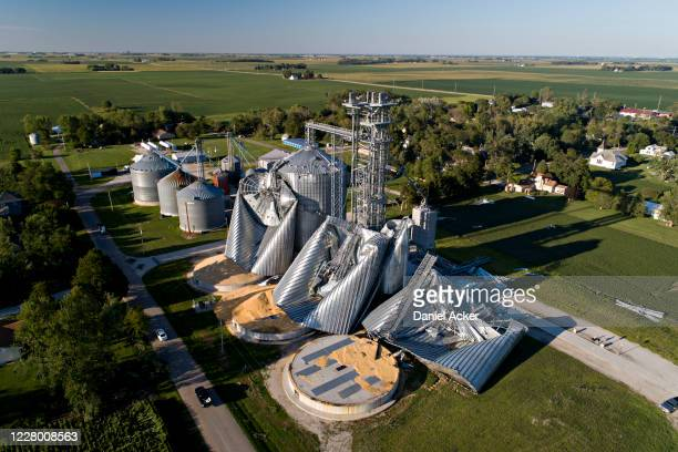 In this aerial image from a drone, damaged grain bins are shown at the Heartland Co-Op grain elevator on August 11, 2020 in Luther, Iowa. Iowa Gov....