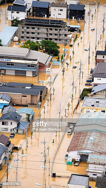In this aerial image Fukuchiyama City center is inundated on August 17 2014 in Fukuchiyama Kyoto Japan Fukuchiyama City recorded 3035 millimeters...