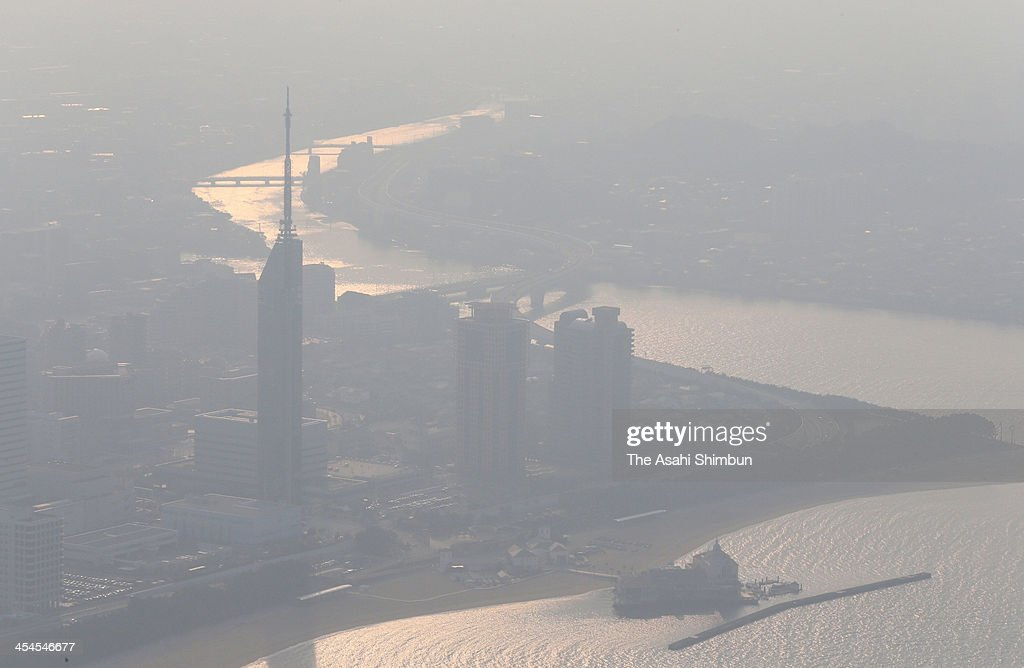 In this aerial image, Fukuoka City is shrouded in polluted smog on December 6, 2013 in Fukuoka, Japan. Th esmog flows in from China, hitting Kyushu area of Japan.