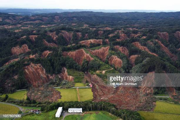 In this aerial image houses are buried by multiple landslides after a powerful earthquake on September 6 2018 in Atsuma Hokkaido Japan The magnitude...