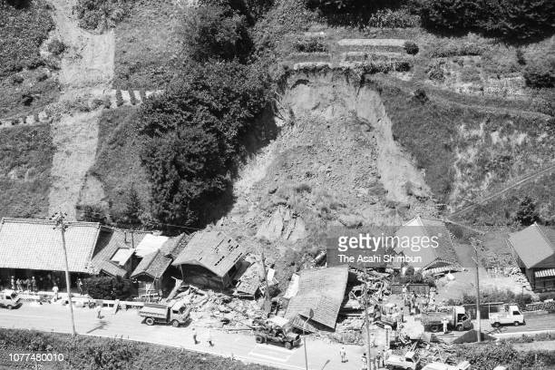 In this aerial image, houses are damaged by a landslide after Typhoon Bess hits across Japan on August 2, 1982 in Ureshino, Mie, Japan.