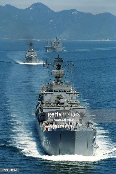 In this aerial image Japan Maritime SelfDefense Force transport ship Miura Ojika and Towada depart for Cambodia to deploy in the peace keeping...