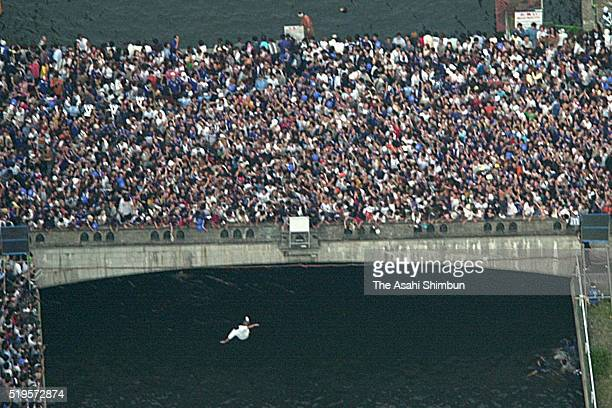 In this aerial image Japanese fans dive in the Dotonbori River to celebrate Japan's win and going through to the knock out stage after the FIFA World...