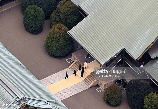 In this aerial image, Japanese Prime Minister Shinzo Abe is seen during his visit to Yasukuni Shrine on December 26, 2013 in Tokyo, Japan. It will...