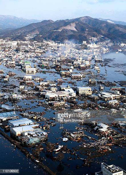In this aerial image Kesennuma city is seen flooded after an 90 magnitude strong earthquake struck on March 11 off the coast of northeastern Japan on...