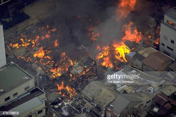 In this aerial image Kobe city is covered with fire and smoke after the Great Hanshin earthquake on January 18 1995 in Kobe Hyogo Japan Magnitude 73...