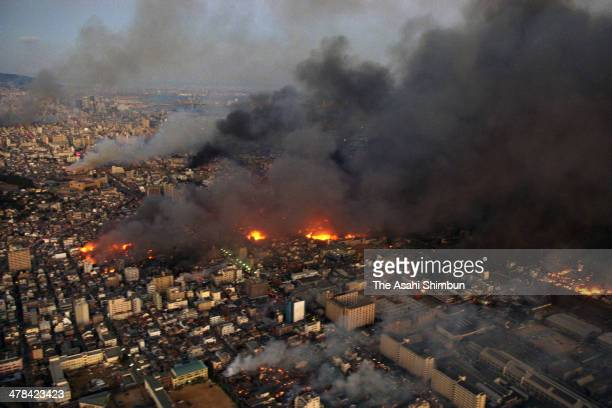 In this aerial image Kobe city is in blaze after the strong earthquake on January 17 1995 in Kobe Hyogo Japan Magnitude 73 strong earthquake jolted...