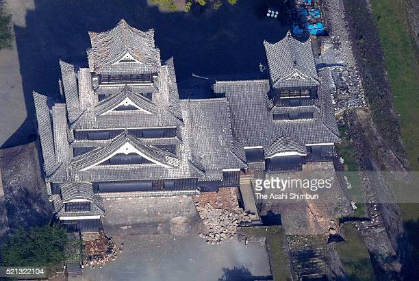 In this aerial image Kumamoto Castle is dameged after the magnitude 64 earthquake jolted on April 15 2016 in Kumamoto Japan At least 9 people were...