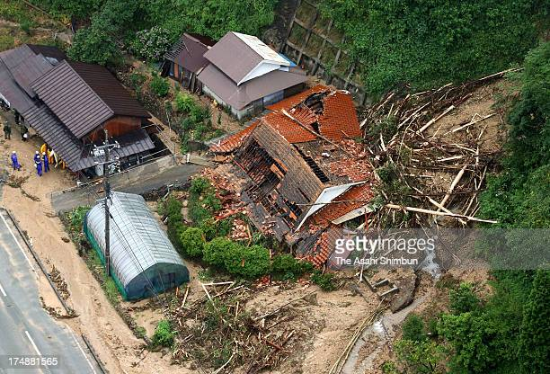 In this aerial image landslide destroy a house on July 28 2013 in Yamaguchi Japan A woman confirmed dead and two missing an evacuation warning has...