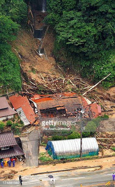 In this aerial image, landslide destroy houses on July 28, 2013 in Yamaguchi, Japan. A woman confirmed dead and two missing, an evacuation warning...