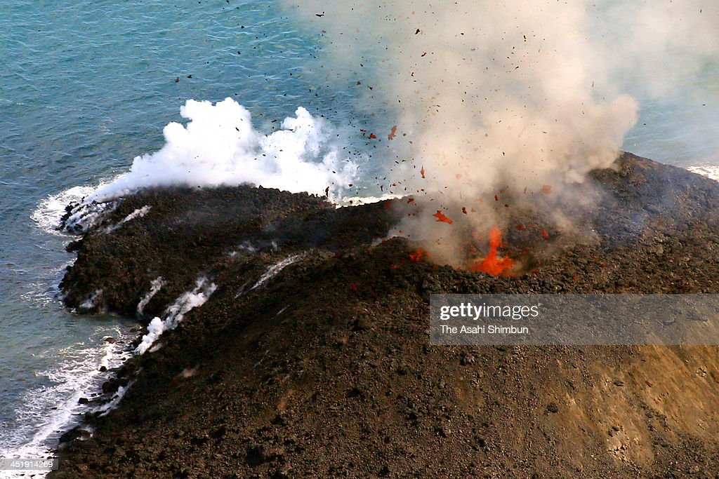 In this aerial image, lava and debris erupt from a new volcanic island, which was spotted near the uninhabited island of Nishinoshima in the Ogasawara chain on November 24, 2013 in Ogasawara, Tokyo, Japan. The volcanic island has grown to more than 20 meters in height since it was first spotted by the Japan Coast Guard on November 20, about the same height as nearby Nishinoshima island, with its highest point of 25 metres.