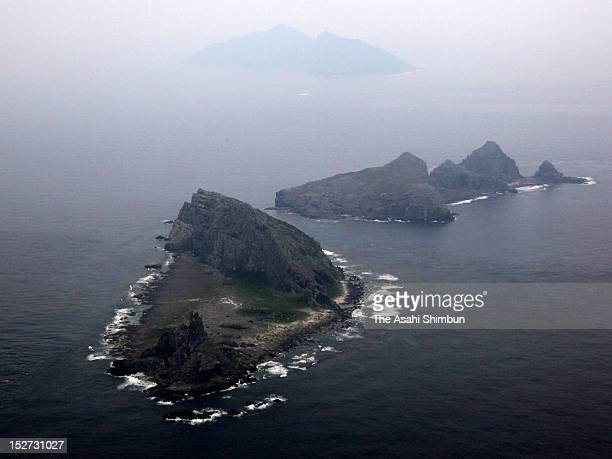In this aerial image Minamikojima Kitakojima and Uotsurijima are seen at Senkaku/Daioyu Islands on September 19 2012 in Ishigaki Okinawa Japan...