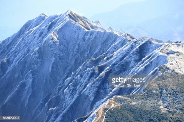 In this aerial image Mt Daisen is covered with the first snow of the season on October 31 2017 in Daisen Tottori Japan It is a day earlier than...