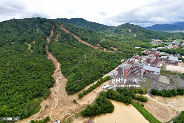 In this aerial image multiple landslides happen due to heavy rain on July 7 2018 in Higashihiroshima Hiroshima Japan 51 people were killed and 58...
