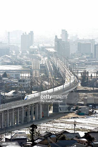 In this aerial image new Hokuriku Shinkansen bullet train departs from the Toyama Station on March 14 2015 in Toyama Japan A string of ceremonies are...