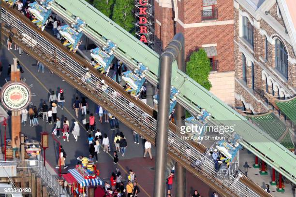 In this aerial image passengers of rollercoaster Flying Dinosaur are hung in the air after the emergency stop at the Universal Studio Japan on May 1...