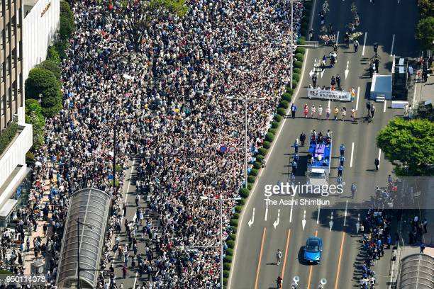 In this aerial image people cheer Sochi and PyeongChang Winter Olympic Games Figure Skating Men's Single gold medalist Yuzuru Hanyu during the parade...