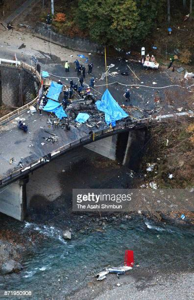 In this aerial image police and firefighters investigate the crash site of an AS332 helicopter on November 8 2017 in Ueno Japan A private helicopter...