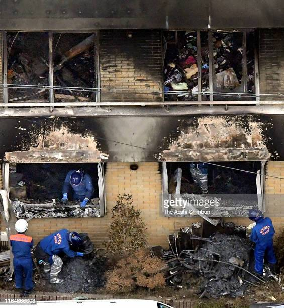 In this aerial image police officers and fire fighters investigate the burnt Kyoto Animation Studio building on July 19 2019 in Kyoto Japan 33 people...