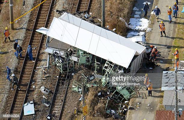 In this aerial image police officers investigate the collision site of a truck and a JR Sanyo Line train on February 13 2015 in Kurashiki Okayama...