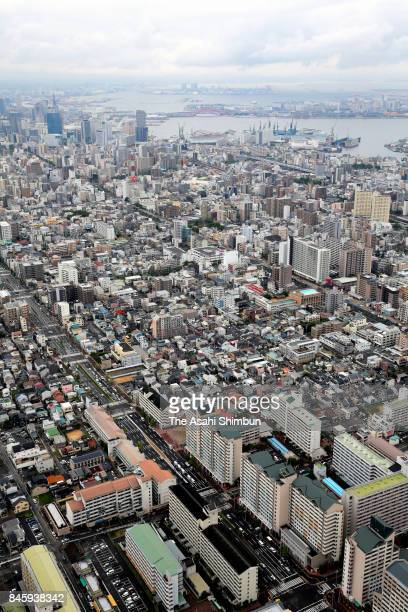 In this aerial image police officers investigate the fatal shooting of a suspected Yakuza gangster on September 12 2017 in Kobe Hyogo Japan The man...