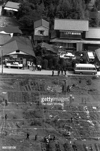 In this aerial image, police officers investigate the site where suspect TSutomu Miyazaki confessed that he had burnt bones of killed girl on August...