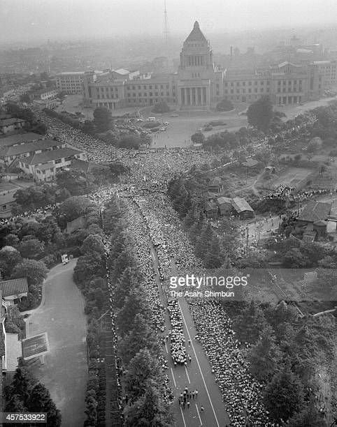 In this aerial image protesters against the USJapan security treaty surround the diet building on June 18 1960 in Tokyo Japan