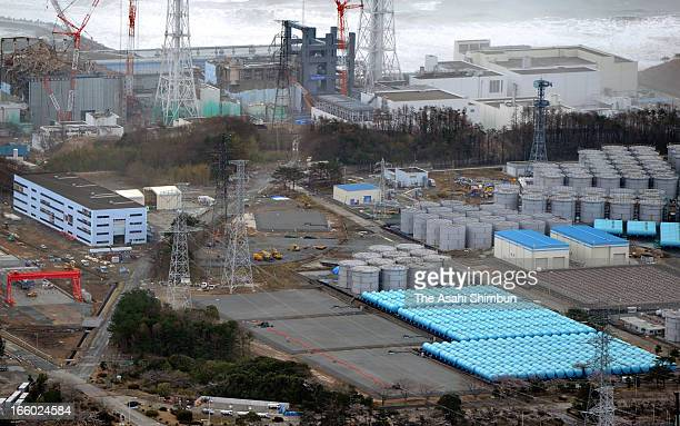 In this aerial image radiation contaiminated water storage tanks are seen at crippled Fukushima Daiichi Nuclear Power Plant on April 7 2013 in Okuma...