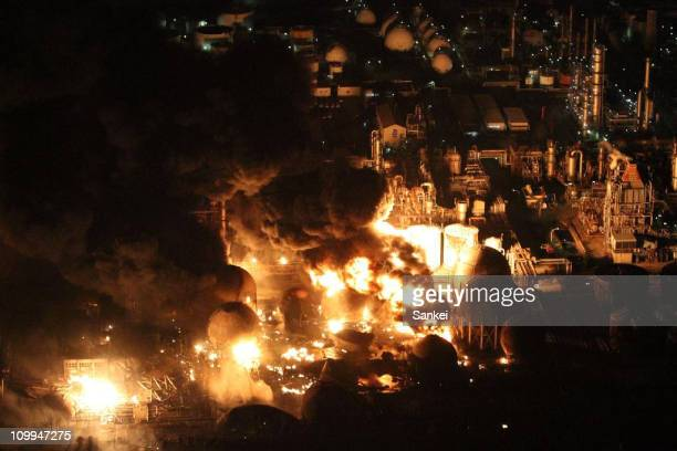 In this aerial image, refinery plants of Cosmo Oil Co., Ltd are on fire on March 11, 2011 in Ichihara, Chiba, Japan. An earthquake measuring 8.9 on...