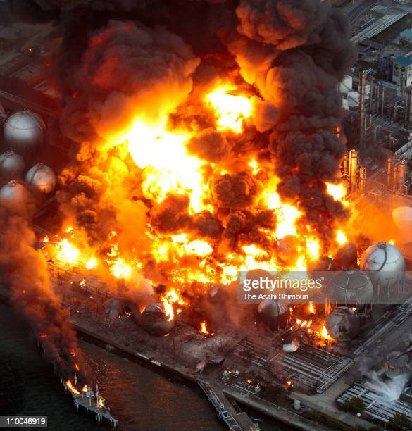 In this aerial image, refinery plants of Cosmo Oil Co., Ltd are on fire after a 9.0 magnitude strong earthquake struck off the coast of north-eastern...
