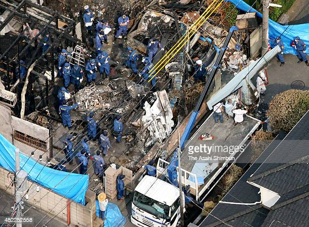 In this aerial image removal work of the crashed airplane continues on July 29 2015 in Chofu Tokyo Japan