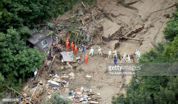 In this aerial image rescue operation continues as a landslide collapse houses on July 7 2018 in Takehara Hiroshima Japan 51 people were killed and...