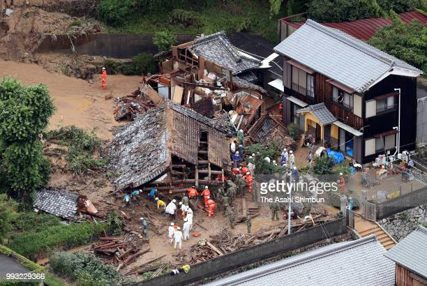 In this aerial image, rescue operation continues at the house where three women are missing after a landslide at Nuwajima Island on July 7, 2018 in...