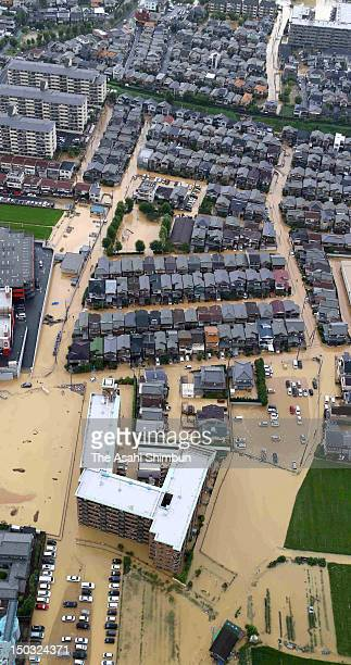 In this aerial image residential area are flooded by torrential rain on August 14 2012 in Uji Kyoto Japan