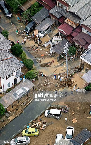 In this aerial image residents work on clean up after the flood receded on August 14 2012 in Uji Kyoto Japan