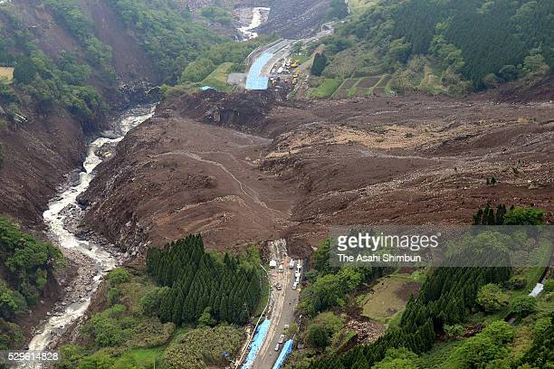 In this aerial image, restoration work of the washed Aso Ohashi Bridge continues on May 7, 2016 in Minamiaso, Kumamoto, Japan.